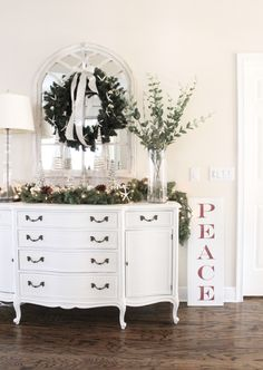 """You may have gotten a peek at our Entry decorated for Christmas last week during my mini-tour for the blog hop, but I am back today with more photos and details! I mentioned in a previous post that my family voted on """"REDS"""" for Christmas this year, as you know, I like to change things …"""