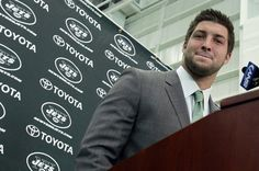 Love it! A picture is worth a thousand words & this one is definitely a keeper!   QB Tim Tebow addresses hundreds from the media during his first press conference held the Jets Training Center. Florham Park, NJ Robert Sciarrino/The Star-Ledger