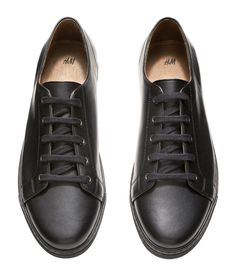Embody urban cool from head to toe with these premium-quality black leather lace-up sneakers. | H&M For Men