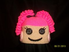 Toddler curly hair and button eyed character hat. If you are interested in this hat or want to make a request. You can contact me on my business page Jennifer's Unique Crochet.