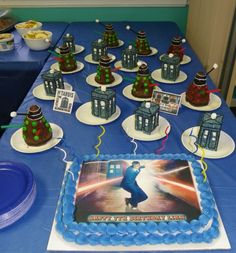 doctor who cake w/ rice crispie tardis and dalek cupcakes (i assume that from the pic) https://fbcdn-sphotos-d-a.akamaihd.net/hphotos-ak-snc6/190578_10201209674592231_935516038_n.jpg  This is kinda cool too. Granted, we won't be turning 7 for our next b'day so the big cake is a bit un-necessary. However, a rice krispie Tardis is the best idea EVER. Just throwing that out there.