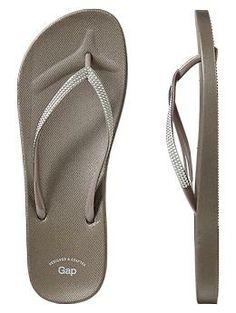 Metallic rubber flip flops. Practical but still stylish. Great for beach or shower.  Gap.
