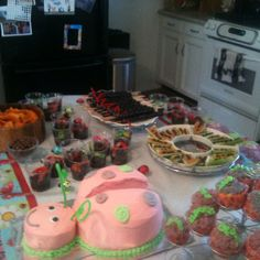 A Bug Birthday Party ...   Lady Bug Cake designed and made by yours truly :)   Ants on a log (celery, peanut butter, raisins)  Dirt Cups (chocolate pudding, mashed Oreos, gummy worms) Caterpillars (skewer grapes, twizzlers)  Rollie Pollies (Meat balls and chocolate covered raisins)