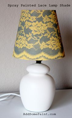I like this lamp shade treatment - spray painted lace lampshade tutorial DIY