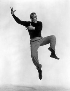 Jacques Tati by Philippe Halsman, from the Jumping Series (1954)