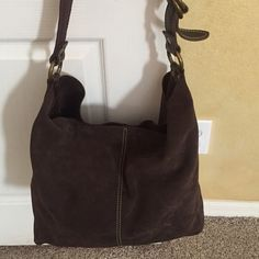 "Fossil brown suede large Hobo handbag Fossil brown suede Hobo bag with inside attached wallet. Great looking bag showing minor wear with an adjustable shoulder strap. Snap closure in the inside with a 7.5 x 4.5"" snap closed wallet. Bag strap measures approx 21"" from one side to another. Length measured on the bottom is 13"" and bag sitting upright measures also 13"" Great multi purpose bag. Fossil Bags Hobos"