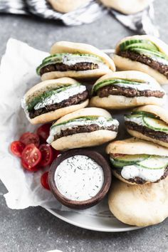These Mini Lamb Burgers with Dill Greek Yogurt taste like a classic Greek gyro in bite-sized form. Crispy patties of ground lamb are nestled into mini pita pockets, stuffed with sliced cucumbers, and drowned in an easy dill and lemon-infused Greek yogurt. Lamb Burgers, Mini Burgers, Turkey Burgers, Veggie Burgers, Lamb Recipes, Healthy Recipes, Penne Recipes, Hamburger Recipes, Lamb Patties