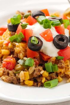 Delicious beef and rice are combined with tomatoes, mexicorn, and salsa, then topped with gooey cheese and baked until golden for the easiest and most delicious taco bake casserole. #centslessmeals #easytacocasserole #tacobakecasserole #tacoricecasserole #simplerecipe #withrice #bakesimple #groundbeef #easyrecipe #casserole Mexican Food Recipes, Beef Recipes, Chicken Recipes, Mexican Dishes, Cheese Recipes, Salsa Chicken, Baked Chicken, Easy Taco Casserole, Chicken Casserole
