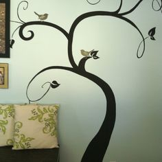 I painted the tree with black, right on the wall and put vinyl birds from shopko on the branches.