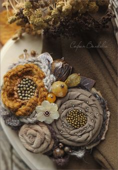 Lovely handmade fabric flowers with beads. so rustic!