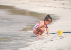 My daughter playing in the sand at Isla Palomino, Puerto Rico