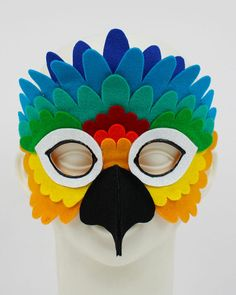 Get bright and take flight in this Rainbow Parrot Mask This Rainbow Parrot Mask is crafted from hand cut premium wool felt feathers in vibrant shades of yellow, orange, tangerine, red, green, turquoise and blue. All of my masks are designed for comfort and durability, they are