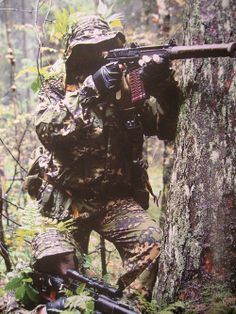 """Russian Spetsnaz on patrol with the specialized SR-3M """"Vikhr"""" assault rifle."""
