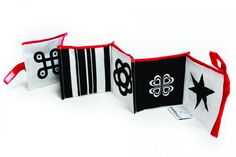 "This black and white, folded down book has been created for the youngest children. It rustles during play garnering the young ones' attention while the patterns used in the project have a positive effect on their psychomotor development. The dyes used in the production process are hypoallergenic. The book is manually sewn together and the material is certified ""Child Safe""."