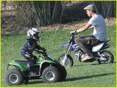 Cute! Brad Pitt on a mini bike.