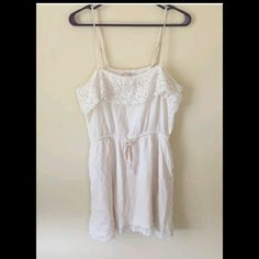 NWOT White Crochet Summer Dress Pictures do not do it justice! Super soft!!! Adorable, cotton, mini, adjustable straps. Will fit a small or extra small. Perfect for beach or date night! Stretchy. Crochet detail along bottom too, gorgeous in person!! Never worn! It even has pockets! Forever 21 Dresses