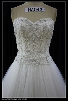 This beaded Tulle ball gown Wedding dress has a sweetheart neckline. The full ball gown skirt can be made more or less full on this wedding dress. We have many other strapless wedding gowns to consider for all sizes and body types. (Custom designs & replicas also available).  Contact us directly for pricing and further details on our process. #weddingdresses #weddinggowns #designerweddingdresses #ballgowns