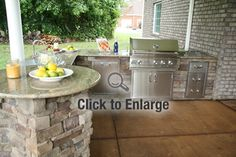 This open outdoor kitchen integrates seating, so the chef can talk with guests.