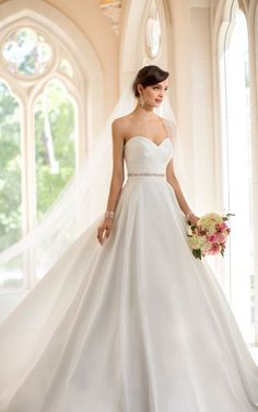 Simply Chic: Stella York Style 5906. French Mikado wedding dress with pockets features a sweetheart neckline and crisscross pleating. #SoStella #WeddingDress