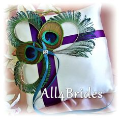 Peacock Feather Wedding Pillow Purple and Teal, Wedding Ring Bearer Pillows, Peacock Wedding Deep Purple, Lapis, Teal. by All4Brides on Etsy https://www.etsy.com/listing/83580651/peacock-feather-wedding-pillow-purple