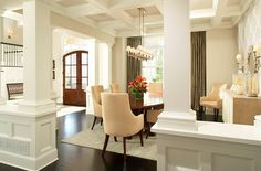 """Dining area with gorgeous trimwork.  Color is Benjamin Moore """"Edgecomb Grey."""""""