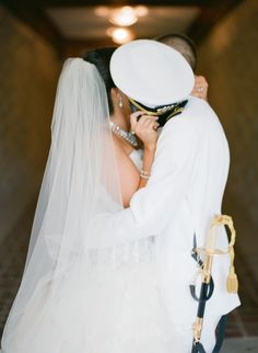 My groom a US Navy Officer in his dress whites and me in my Lazaro wedding dress and cathedral length veil stealing a kiss behind his hat (cover). Wedding Wishes, Wedding Pics, Wedding Bells, Dream Wedding, Wedding Ideas, Navy Military Weddings, Army Wedding, Lazaro Wedding Dress, Wedding Dresses