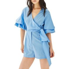 Women's Topshop Drama Sleeve Romper (720 MXN) ❤ liked on Polyvore featuring jumpsuits, rompers, light blue, blue romper, playsuit romper, long-sleeve romper, wrap romper and long-sleeve rompers