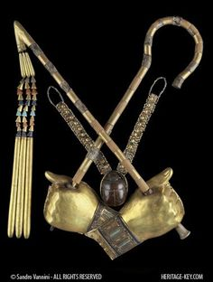 The other symbols of Anubis were the flail, a crook and a 'was' sceptre. A flail was an agricultural tool used for winnowing grain. The flail symbolized the Pharaoh's role as provider of food for his people and the crook symbolized the Pharaoh's role as the 'shepherd' of his people. The long staff, called a 'was' sceptre, was a symbol of divine power and an emblem of authority.