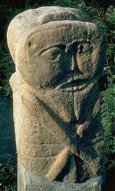 """The male side of a two-sided carved figure in typical """"Celtic"""" squatting mode. Co. Fermanagh."""