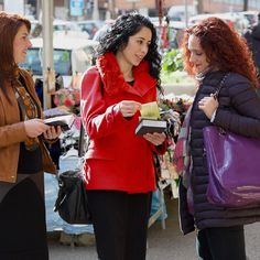 Two Christian sisters preach to a woman on the street