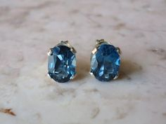 Oval Cut London Blue Topaz Earrings. $40.00, via Etsy.