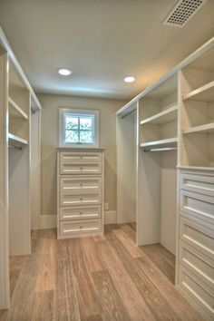 walk in closet organization, really loving the idea of having hardwood floors through out the house