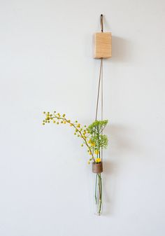 Special tube vase wrapped and hanged on a solid oak cube. Pure and simple presence. Perfect for your kitchen, living room and office.