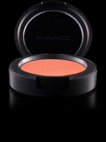 MAC powder blush in Peaches. The perfect shade for folks like me with pretty light skin. This pic looks kind of orange, but it shows up a nice corally pink on my face and looks natural yet highlights my cheek bones.