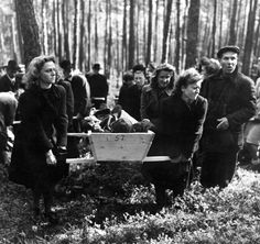 The residents of Neunberg being ordered to exhume and properly bury the bodies from a nearby work camp by the U.S. Third Army. April, 1945.