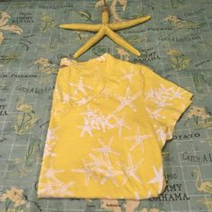 Simply Adorable Starfish Top From Banana Republic Simply Adorable Star Fish Top From Banana Republic. Gently used once. Size: XSP. Background color is yellow with a white star fish print through out shirt. Crew neck. Short sleeves. Machine Wash. Tumble Dry. 100 % cotton. NO TRADES. Banana Republic Tops Tees - Short Sleeve