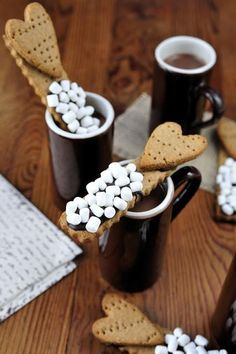 Mini marshmallow and coffee biscuit stirrers.