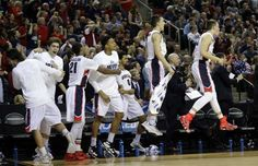 Players on the Gonzaga bench react to a play against Iowa during the first half of the third round of the 2015 NCAA Men's Basketball Tournament at KeyArena on March 22, 2015 in Seattle.