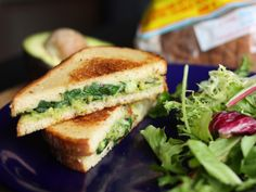 Avocado Pesto Grilled Cheese. This looks spectacular and like a real treat with rye bread, pesto, cheese and avocado