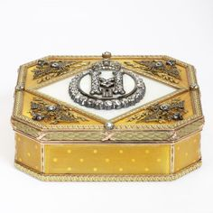 Varicoloured gold presentation box with enamel and brilliant-cut diamonds. Decorated on the lid with the crowned cipher of Tsar Nicholas II, surrounded by Imperial eagles, commissioned from Carl Fabergé, mark of Mikhail Perkhin, 1898-1903.