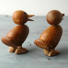 A cute classic Modernist set of two Teak ducklings in a style similar Hans Bolling or Skjode of Denmark. The feet are in good shape, one of the beaks is a little roughed up, but as a whole, they are in good condition. Unlabeled, but probably made in Japan rather than Denmark. This set is very cute, and can be posed in almost unlimited variations for viewing on a mantle or curio case. 3 x 2.75 x 1.5 each