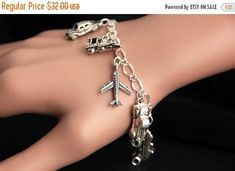 VALENTINE SALE Transportation Bracelet. Charm Bracelet. Automobile Bracelet. Travel Bracelet. Silver Bracelet. Handmade Jewelry. by GatheringCharms from Gathering Charms by Gilliauna. Find it now at http://ift.tt/2DKe6S8!
