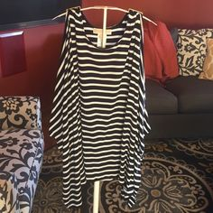 Beautiful Michael Kors Cold Shoulder top  Like new!  Stunning with gold Michael Kors tabs at tops of shoulders. So cute with white shorts or jeans.  MICHAEL Michael Kors Tops