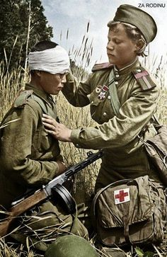 Wounded son of the regiment, a child soldier, is patched up by a child medic in the field. The Red Army: WWII Hiroshima, Nagasaki, Military Women, Military History, World History, World War Ii, Soviet Army, Fukushima, Red Army