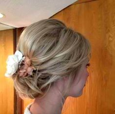Great loose updo for medium length hair. This is beautiful for a bridal hairdo or a bridesmaid hairstyle #DIY #Flower #Wedding day