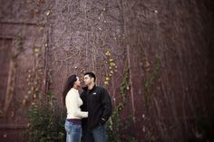 Couple in front of ivy wall tilt-shift -Jeremy Gilliam