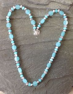 Gorgeous turquoise coloured necklace with faceted Brazilian Aquamarine beads and raised disc beads.