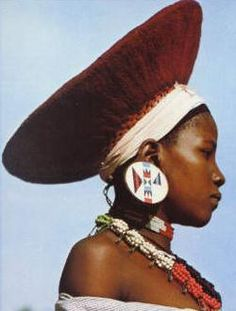 Africa |  Zulu woman wearing her traditional hat and earplugs.  South Africa.