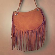 Suede & Fringe Crossbody  by Soriel Anthropologie Sold out EVERYWHERE! This bag is like butter! I love love love it. It's the perfect size. Coachella worthy. Please grab it before I keep it. Anthropologie Bags Crossbody Bags