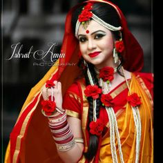 Gaye holud. Orange and red and pose.